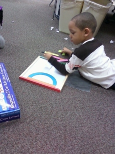 Student using Fundanoodle by Carolina Pad I Can Build Upper Case Letters kit