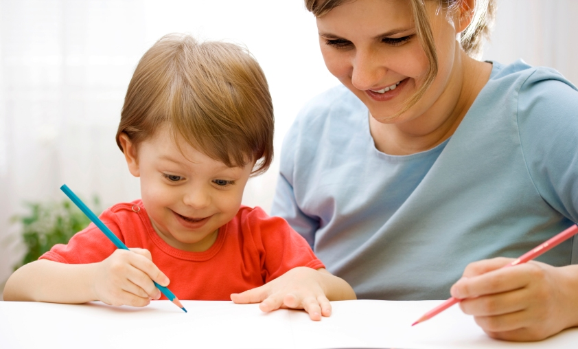 Mother and child drawing together